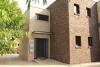 Erstbezug in eine exklusiv ausgestattete 3,5 Zimmer Erdgeschosswohnung in privater Sackgassenlage - Hausansicht