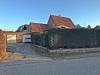 Familienfreundliches Eckgrundstück an der Stadtgrenze zu Hamburg - Garagenzufahrt